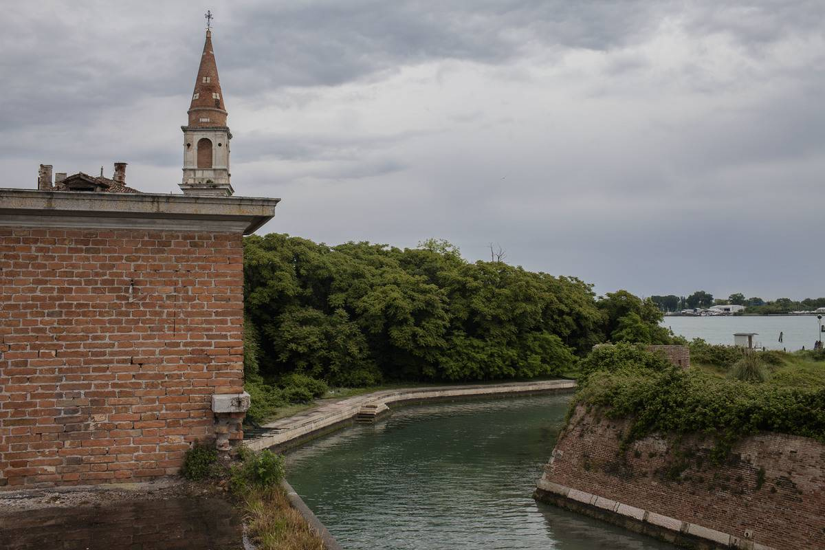 An abandoned mental hospital is seen on Poveglia Island.