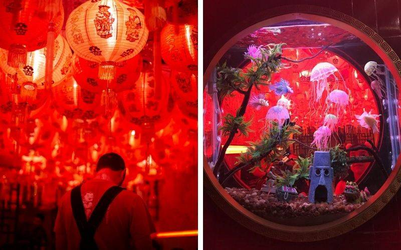 red paper lanterns cover ceiling and fish tank with jellyfish and caribbean decor
