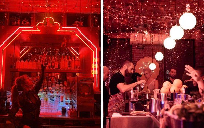 red neon lights around bar, twinkly lights hanging from the ceiling with circular pendulum lights