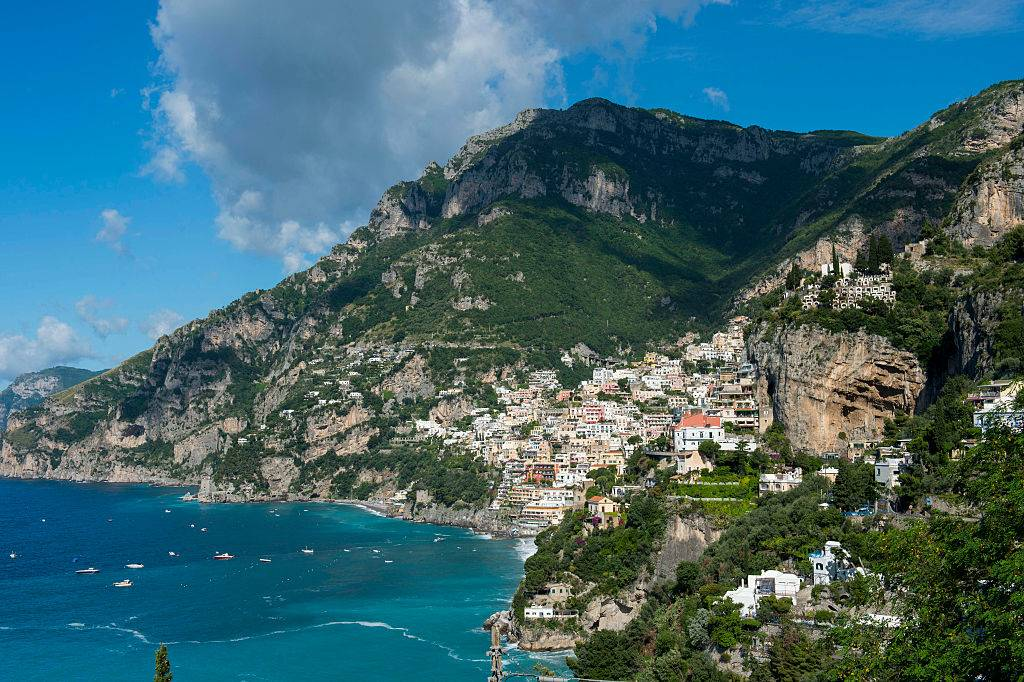 view of the amalfi coast with homes on a hill near the beach