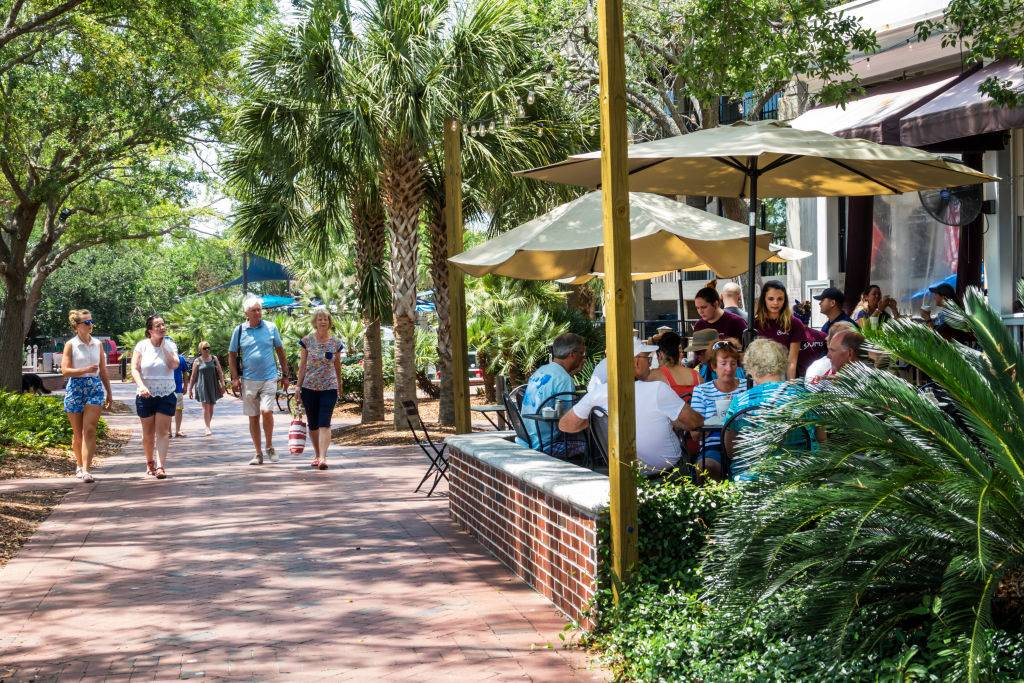 people walking around and eating at a restaurant in Beaufort, South Carolina