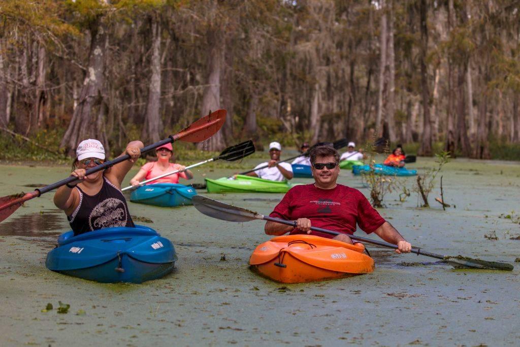 people kayaking in a swamp in Breaux Bridge, Louisiana
