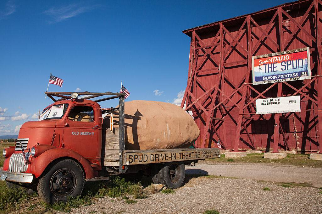 a drive-in with a truck carrying a large potato in Driggs, Idaho