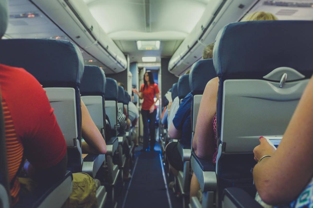 passenger in aisle on plane