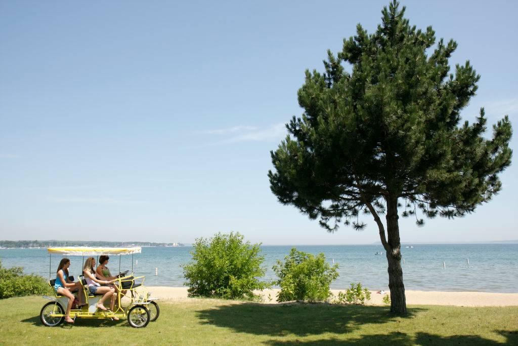 girls riding a quadracycle in Traverse City, Michigan