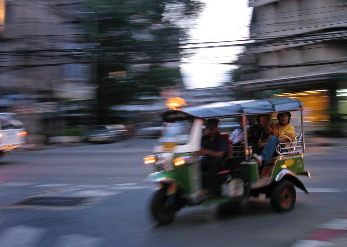 person riding in taxi in thailand