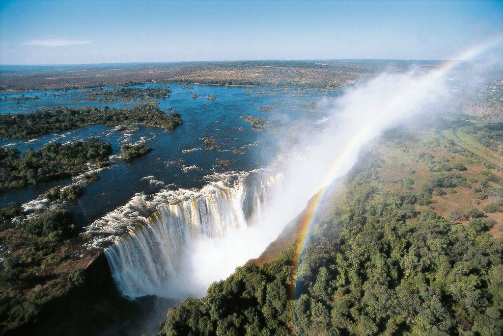 aerial view of victoria falls with a rainbow