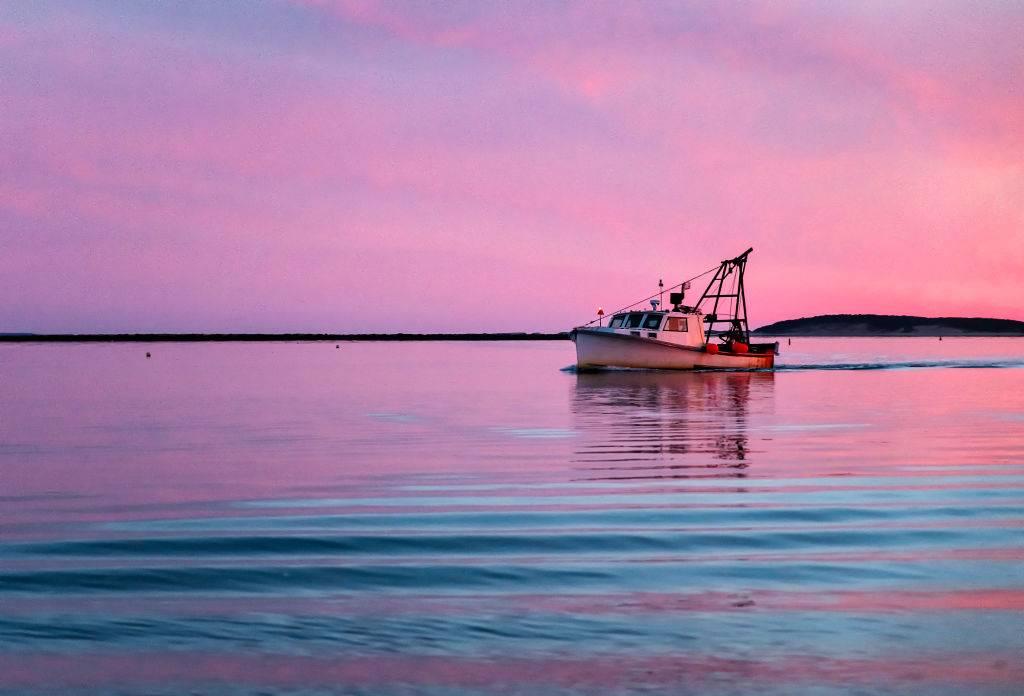 a fishing boat near the edge of the ocean in Wellfleet, Massachusetts
