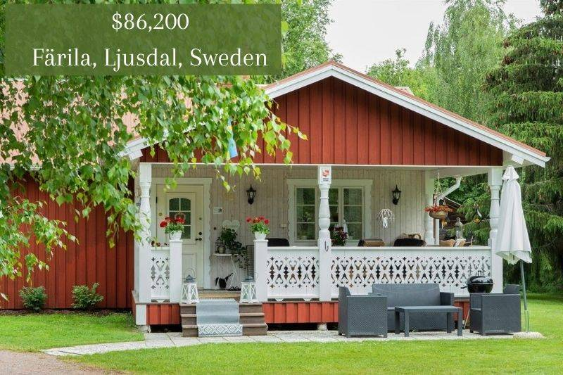a little red house with a cute white porch in Ljusdal, Sweden