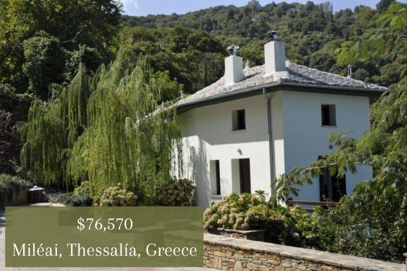 an adorable white house surrounded by greenery in Mileai, Greece