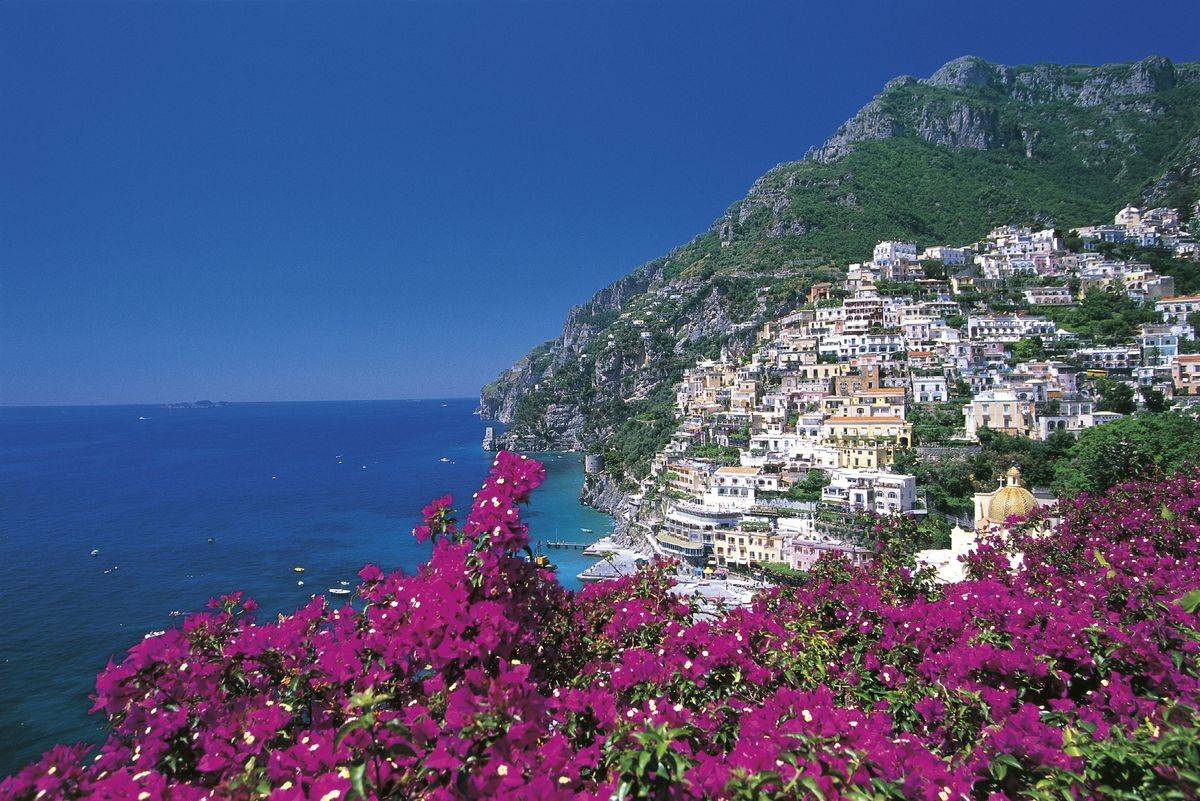 positano amalfi coast italy flowers in foreground