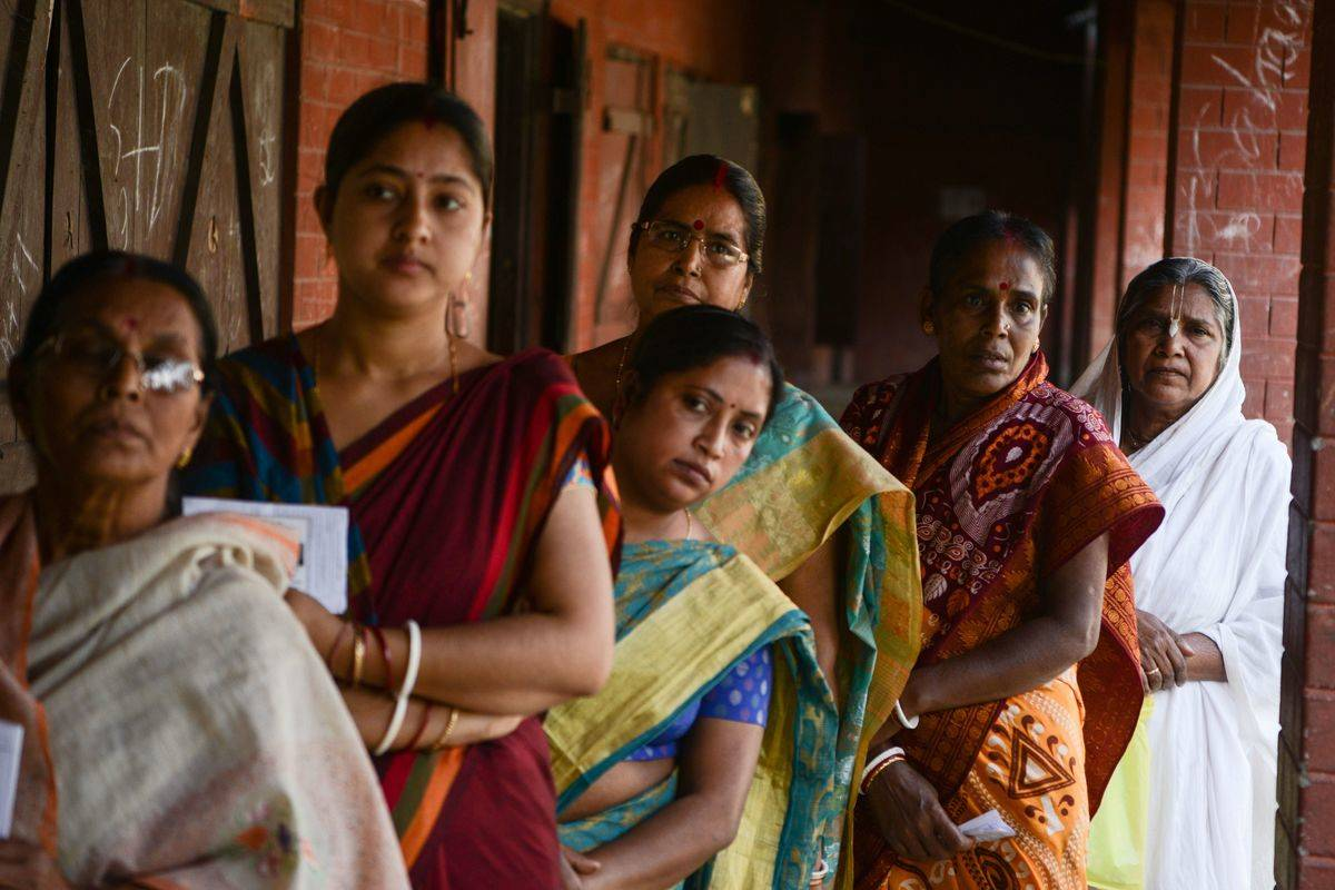 women lined up at polling station in india