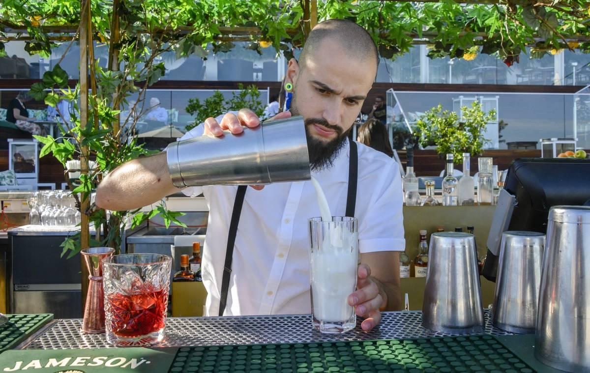 bartender preparing drink in lisbon
