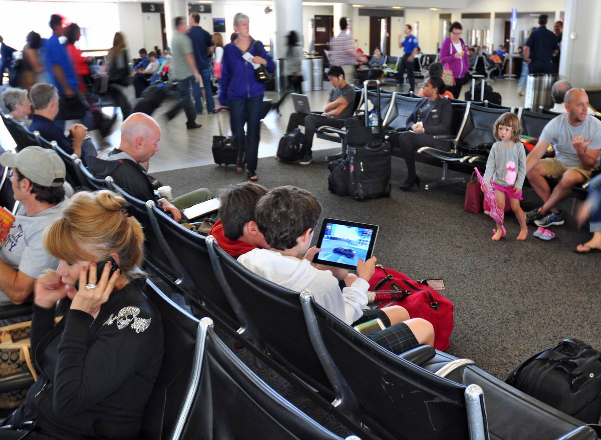 kids in airport using tablet