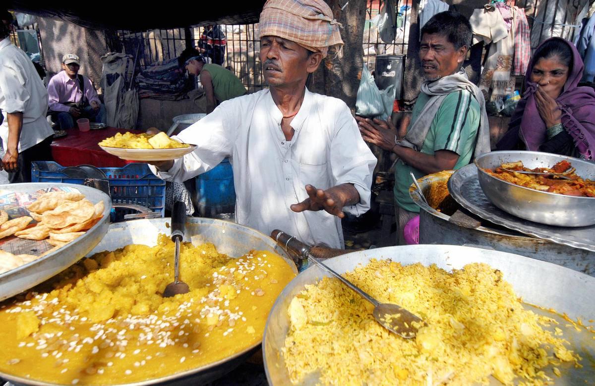 new delhi india street food vendor serving customers
