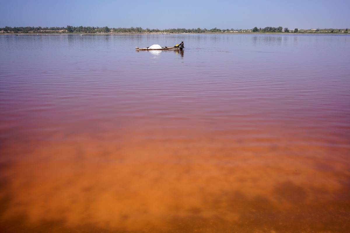 Plumes of orange and red on Lac Rose on the edge of Dakar, Senegal.