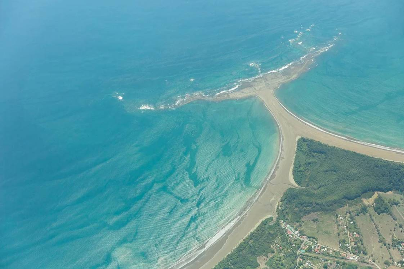 beach shaped like whale tail sticking out into sea