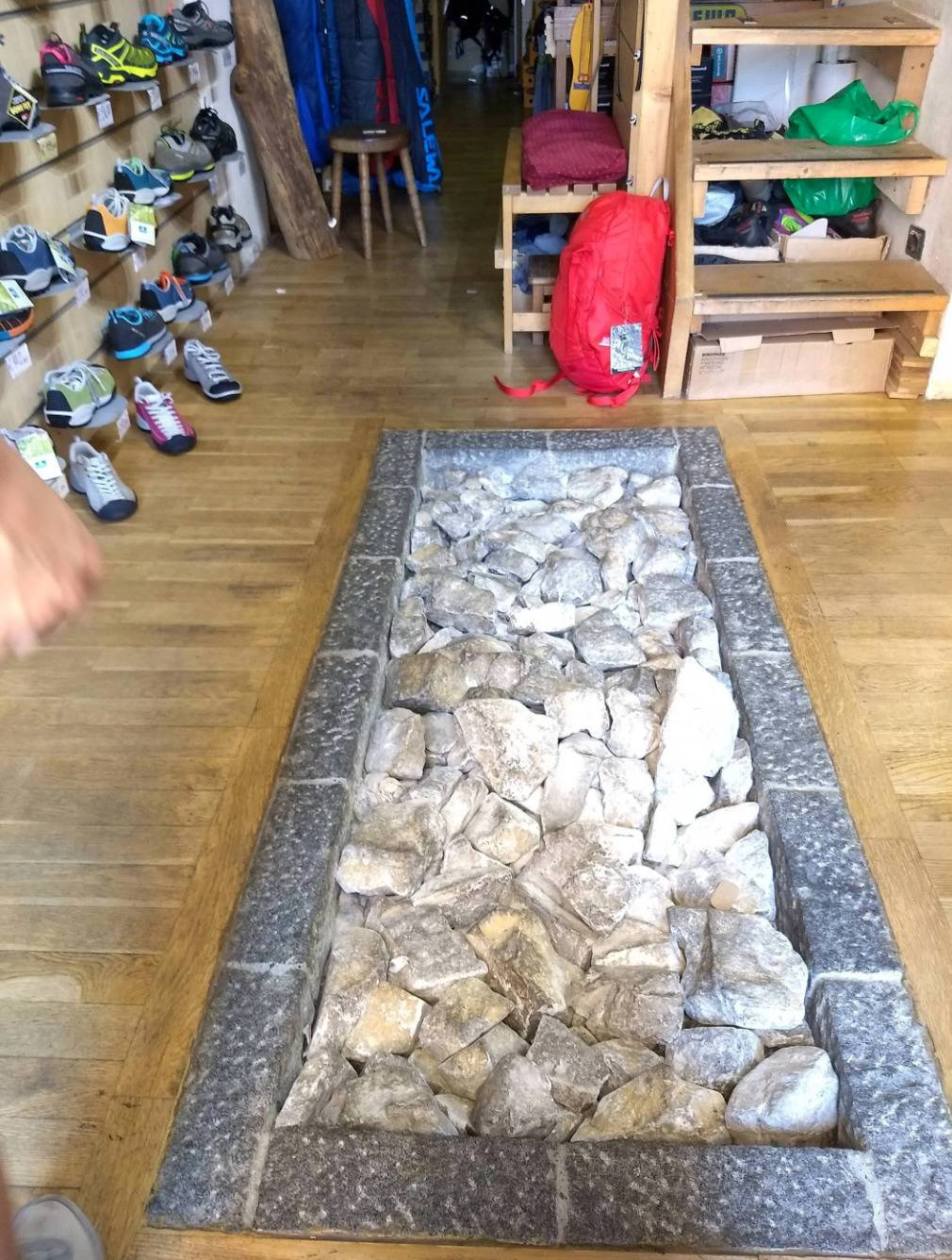 rock testing space near hiking shoes in store