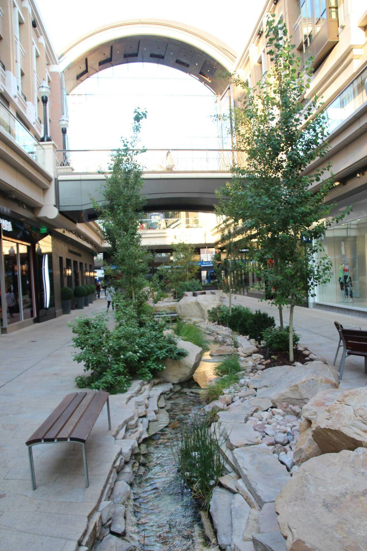 mountain stream crosses through center of outdoor shopping mall