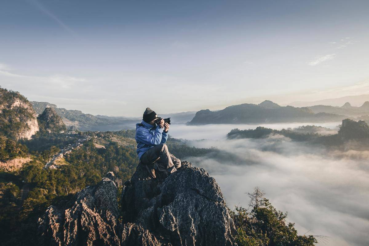 male photographer on cliff