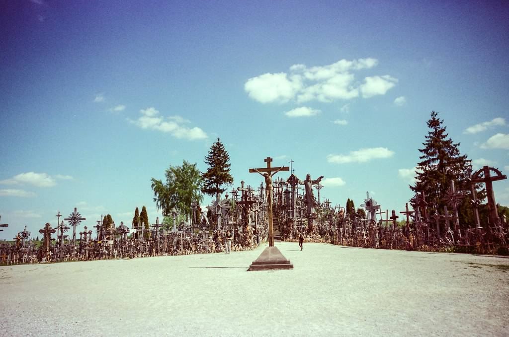 a picture looking at the gate of the Hill of Crosses