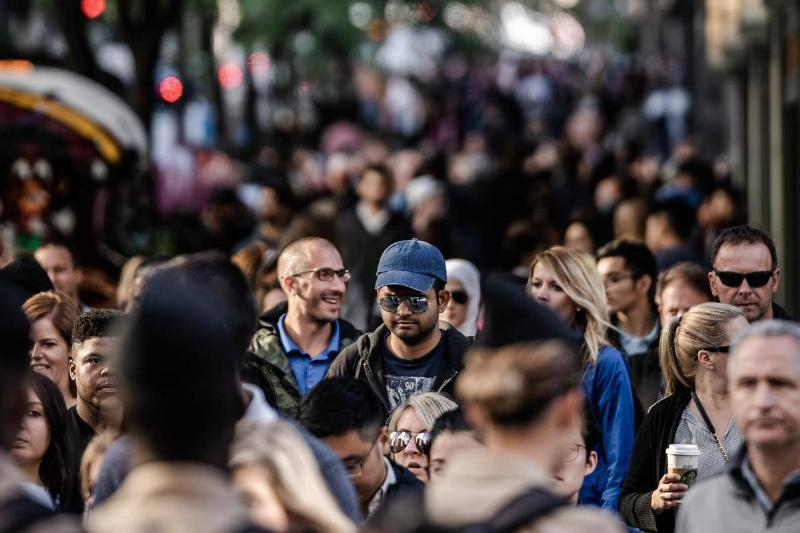 photo of busy street people walking