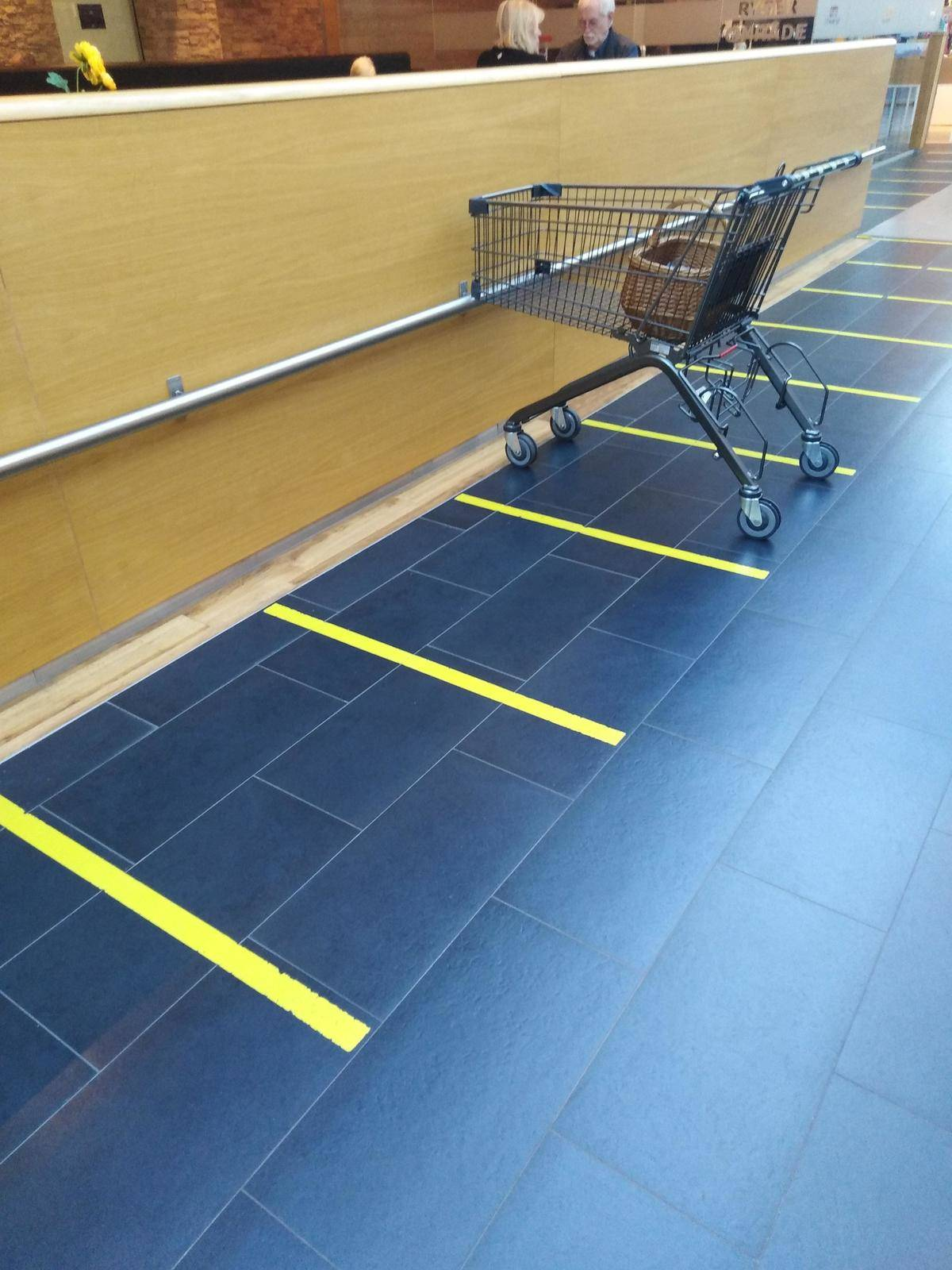 store with parking spots for shopping carts