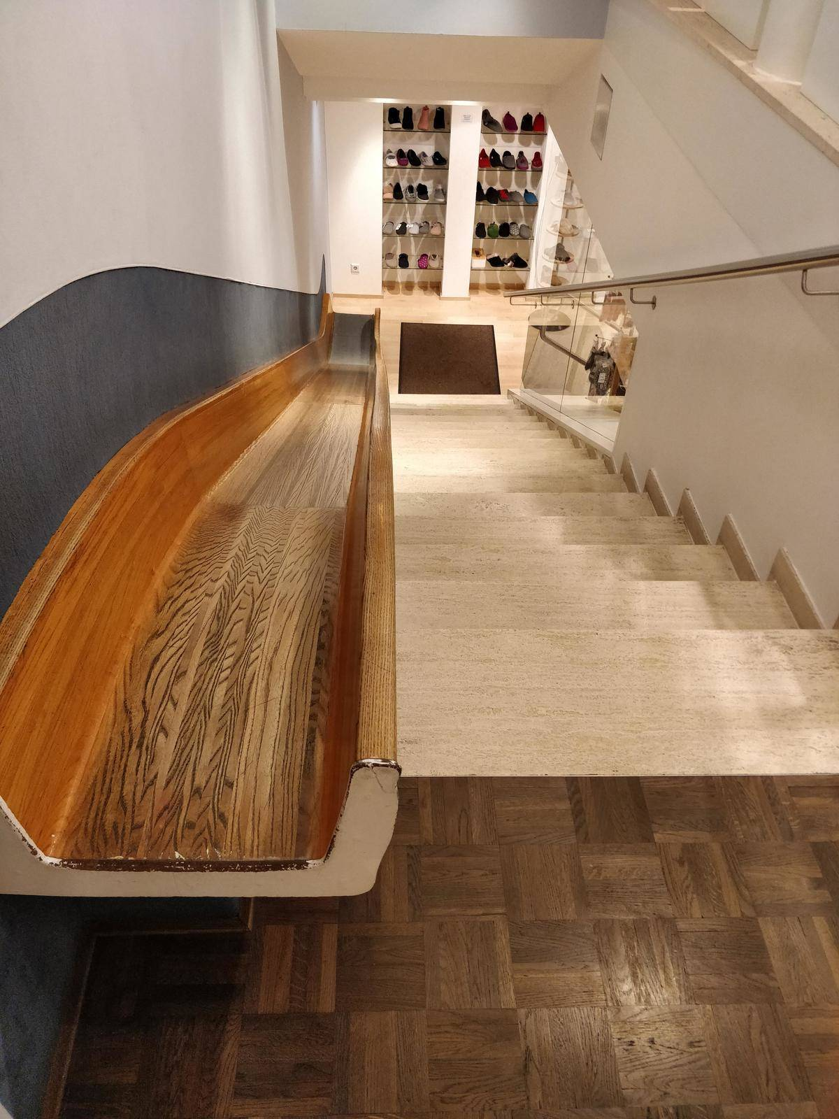 store has slide next to staircase to lower floor