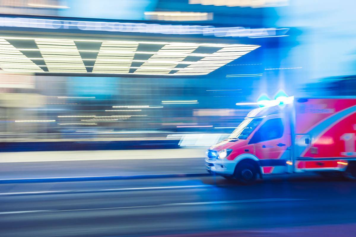 Ambulance rushes by on the street