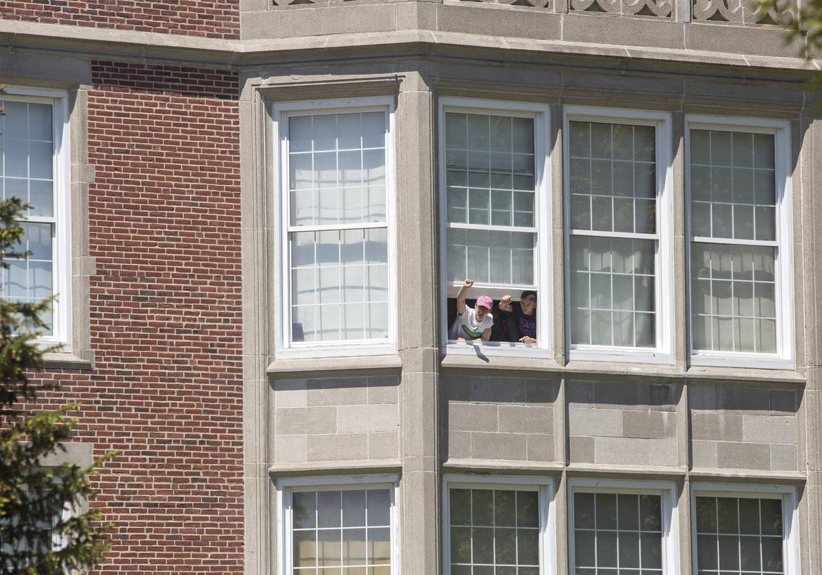 students in portland yelling out window