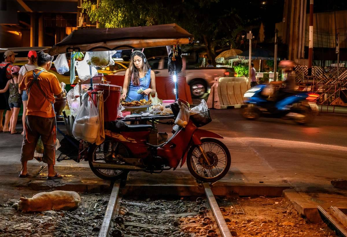 bangkok street vendor woman buying food