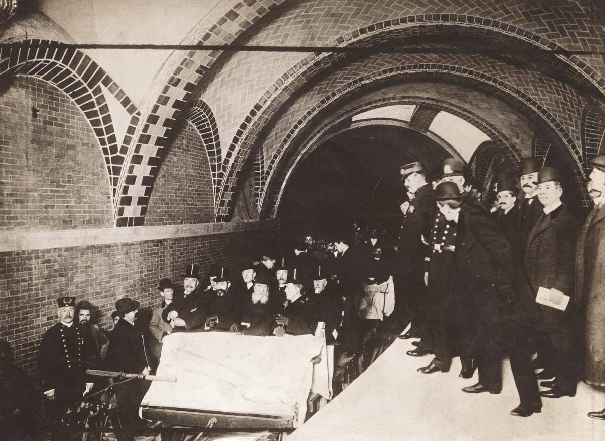 Financiers, city officials, and policemen ride New York City's first subway on October 27, 1904 at City Hall station