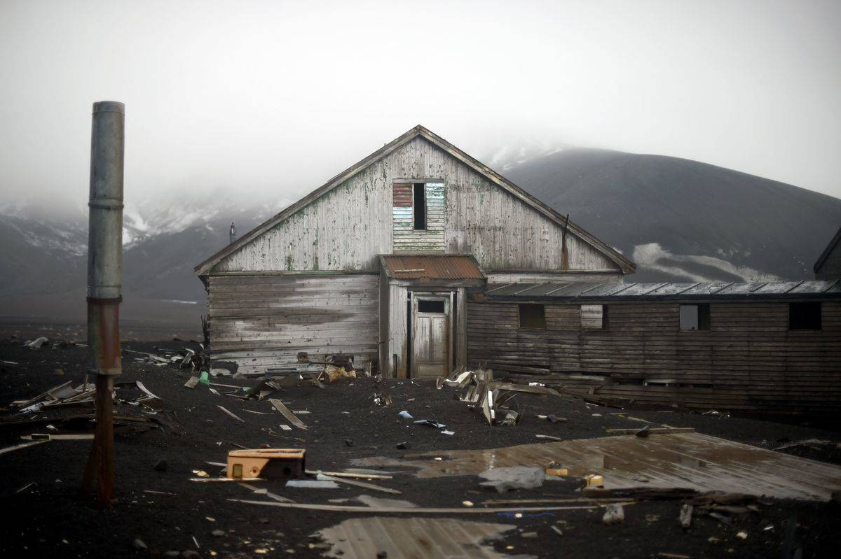 An old building of a British shipping base, which was consumed by a mudslide sparked by a volcano, crumbles at Whalers Bay in Deception Island