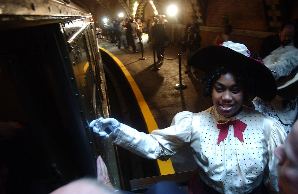 New York City Metropolitan Transportation Authority (MTA) volunteers wearing period customs usher guests to historic City Hall Subway Station.