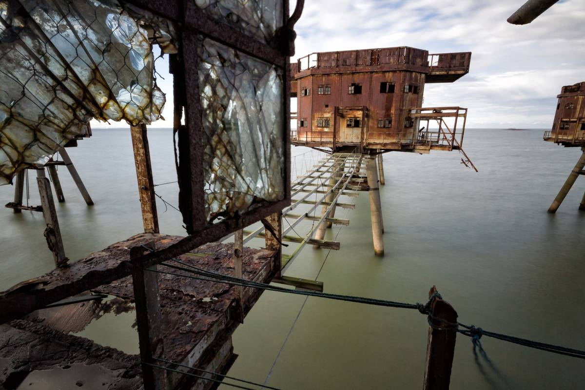 The sea Maunsell forts towering above the mouth of the river Thames estuary in Kent rusted and broken