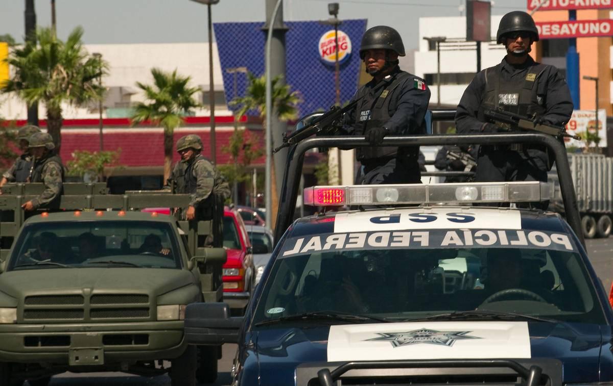 mexican federal police drving through juarez