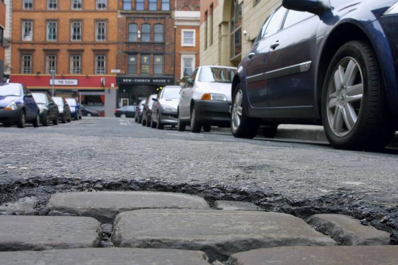 cobble stone streets pothole