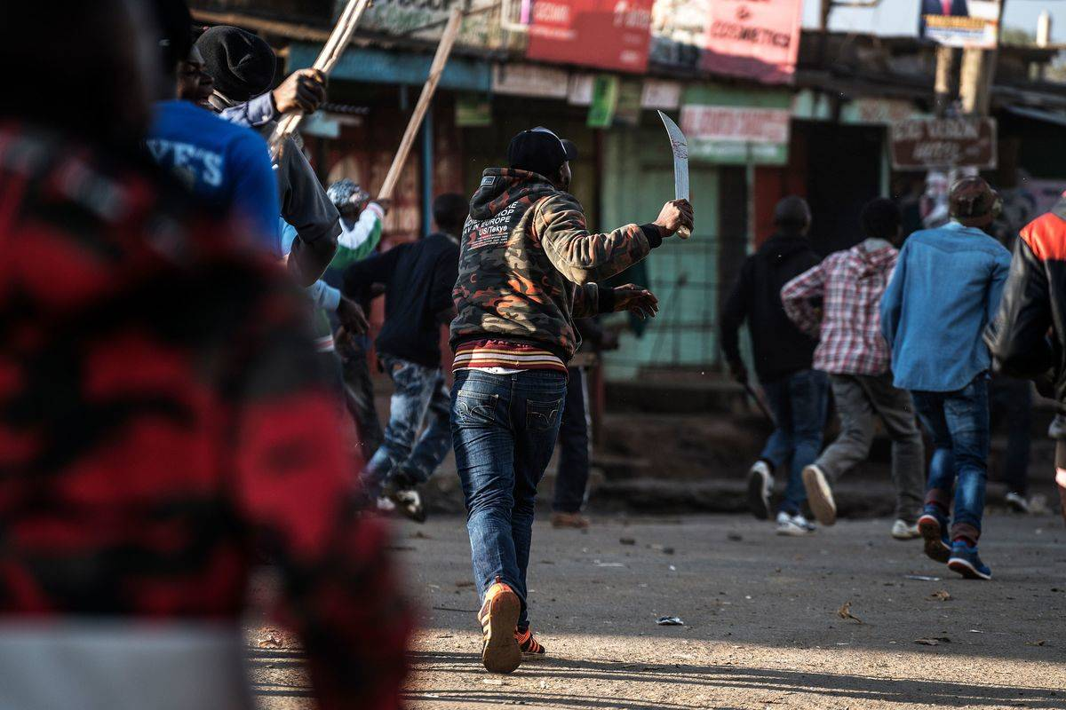 Machete wielding rioters are seen in the Kawangware district of Nairobi