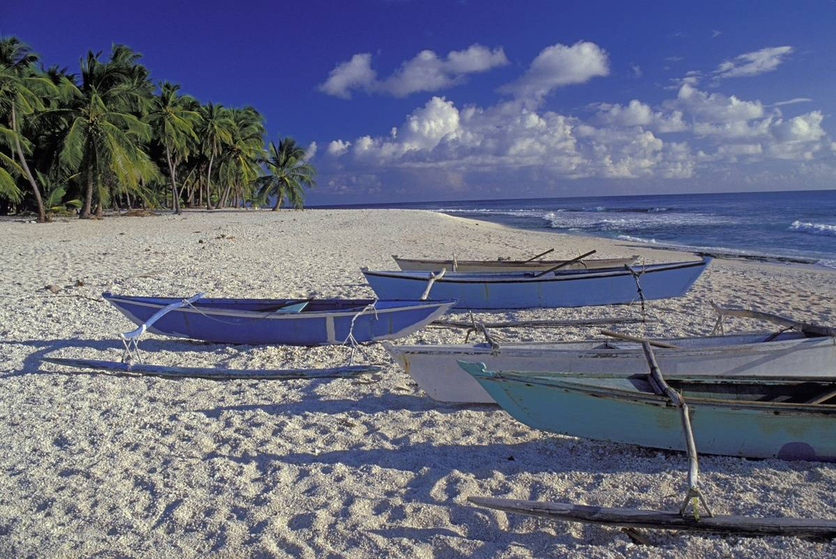 Outrigger Canoes On white sand Beach
