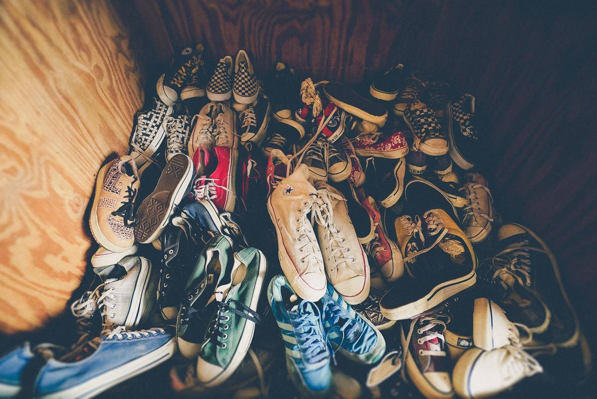pile fo shoes in indoor closet