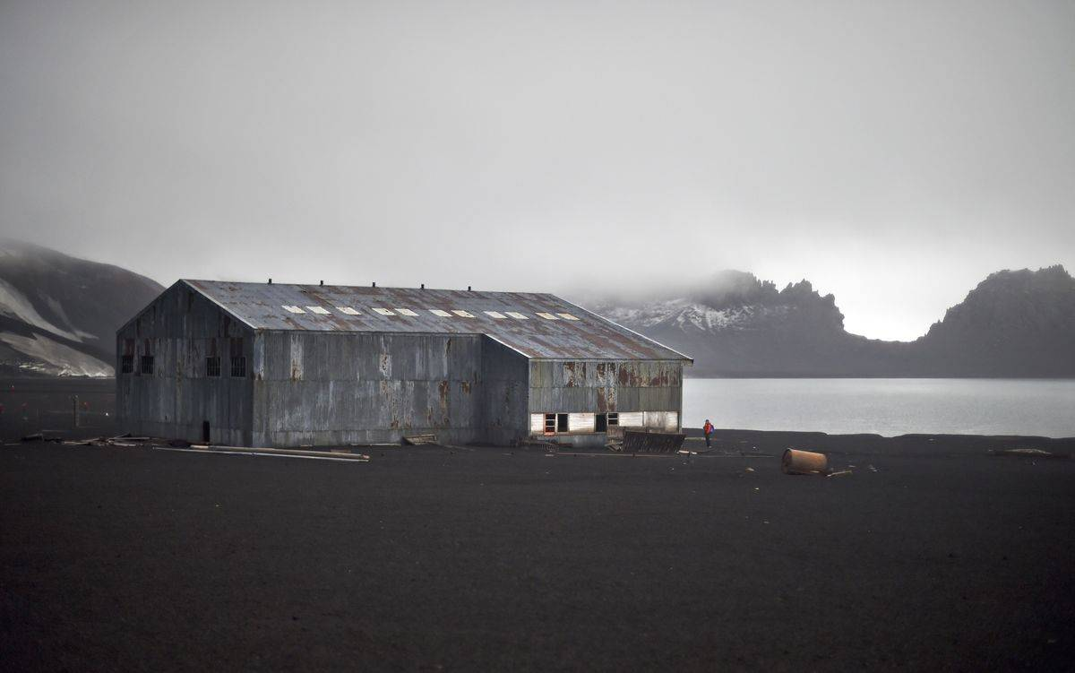 View of a derelict hangar at Whalers Bay in Deception Island, in the western Antarctica peninsula