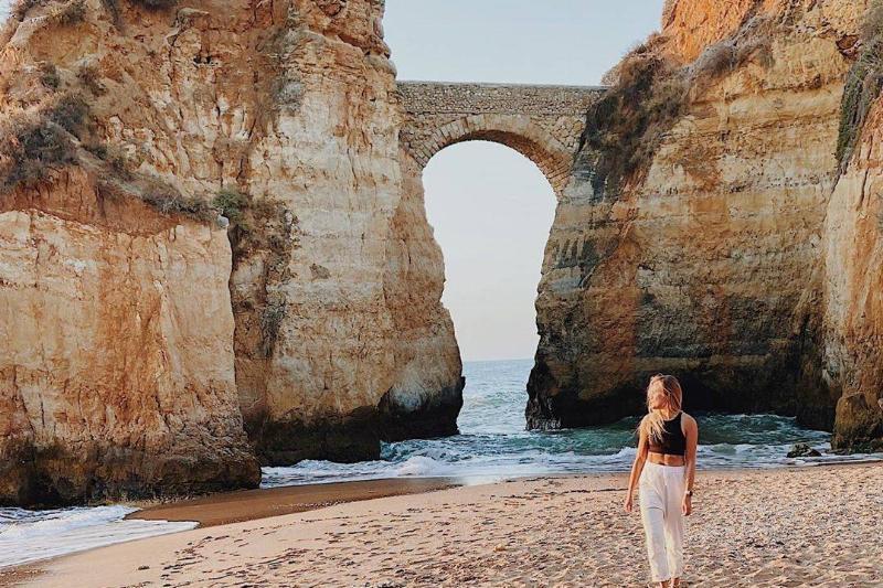 Woman poses in beautiful beach scenery