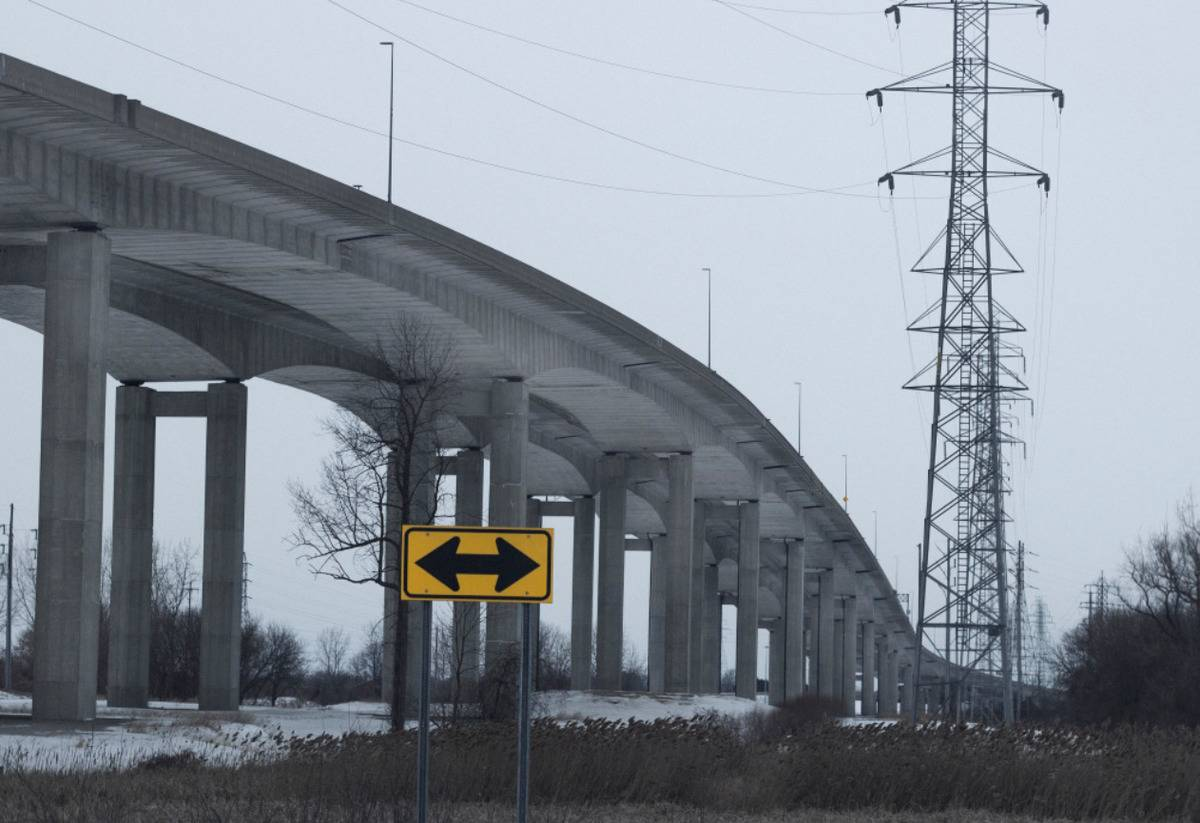 bridge with sign pointing both left and right