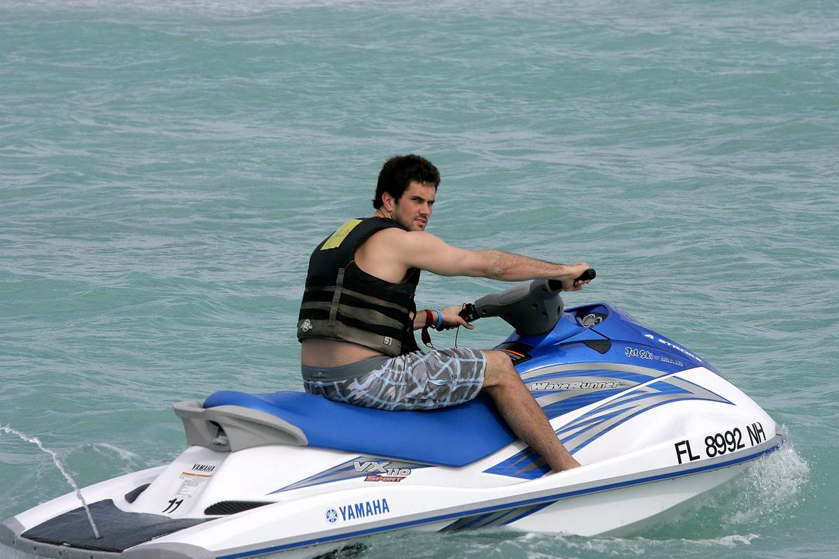 man riding a jet ski on water