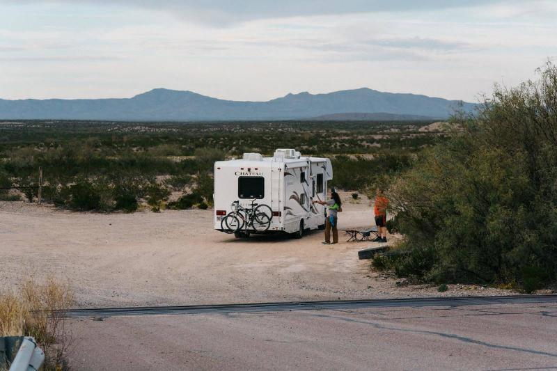 parked camper van in wild landscape