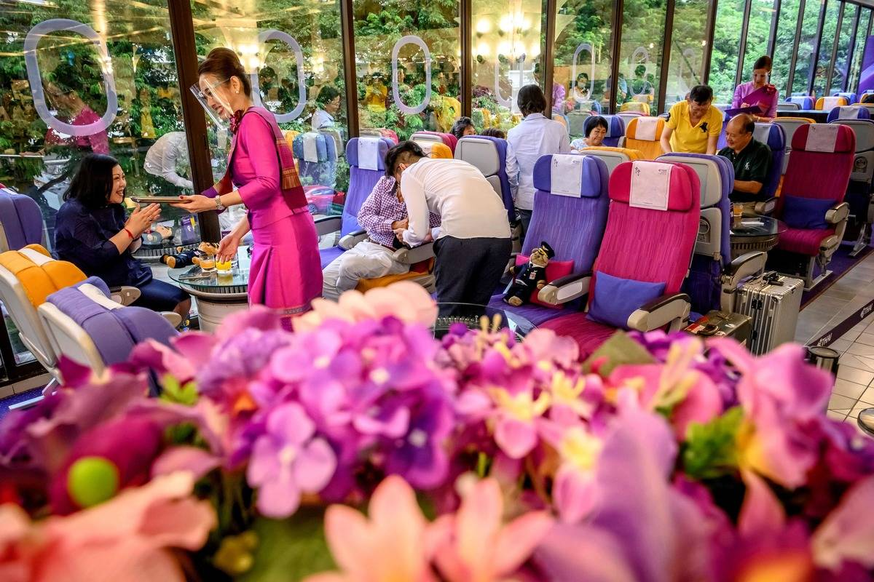thai airways flight attendant face shield at restaurant