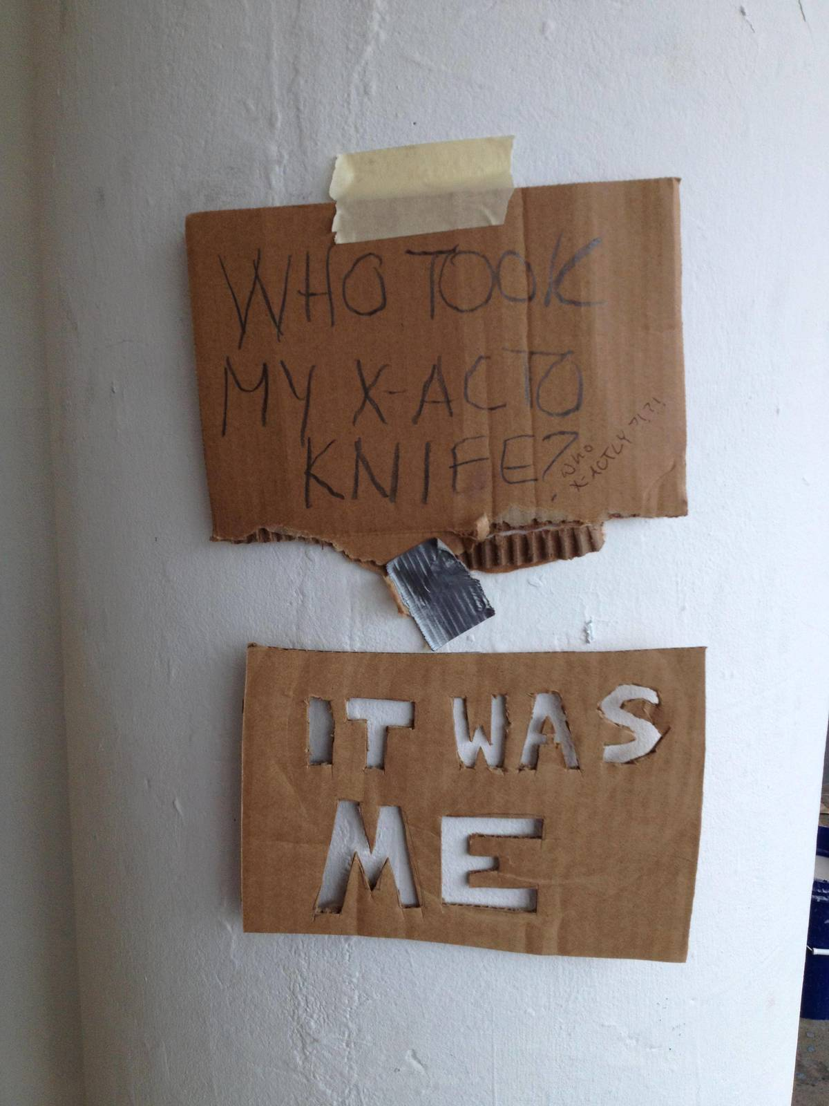 A sign asks for who took someone's X-acto knife, and a carved sign replies