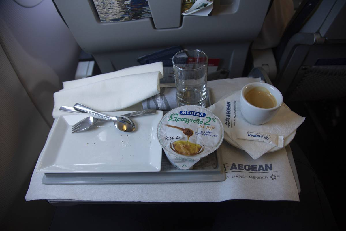 The seatback tray on an airplane contains food.