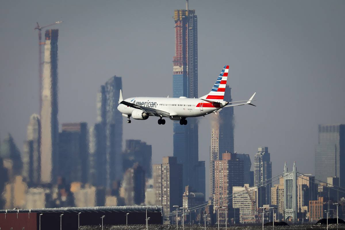 A Boeing 737 takes off from New York in the morning.