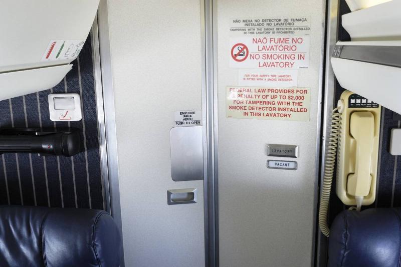 Bathroom doors are seen in a plane.